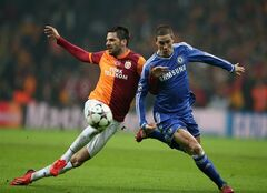 Hakan Balta of Galatasaray, left, and Fernando Torres of Chelsea fight for the ball during their Champions League Round of 16, First Leg soccer match between Galatasaray and Chelsea at Turk Telekom Arena Stadium in Istanbul, Turkey, Wednesday, Feb. 26, 2014. (AP Photo)