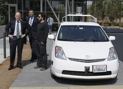 From left, California Gov. Edmund G Brown Jr., state Senator Alex Padilla and Google co-founder Sergey Brin emerge from a driverless car at Google headquarters in Mountain View, Calif., for signing of legislation that paves the way for driverless cars in the state.
