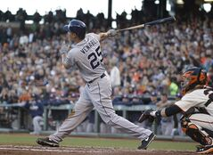 San Diego Padres' Will Venable hits a sacrifice fly off San Francisco Giants starting pitcher Tim Hudson in the third inning of their baseball game, Tuesday, June 24, 2014, in San Francisco. The Padres' Will Venable scored from third base on the play. (AP Photo/Eric Risberg)