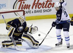 Buffalo Sabres goalie Jhonas Enroth makes a save on a shot by Winnipeg Jets forward Eric Tangradi during the first period of an NHL game in Buffalo, N.Y., Monday.