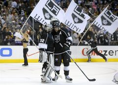 FILE - In this May 16, 2013 file photo, Los Angeles Kings center Anze Kopitar, of Slovenia,, right, celebrates their win with goalie Jonathan Quick in Game 2 of their second-round NHL hockey Stanley Cup playoff series in Los Angeles. After the most successful two-year stretch in franchise history, the Kings just want to keep it going. (AP Photo/Mark J. Terrill,File)
