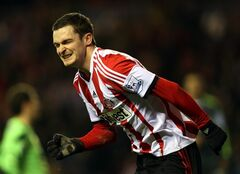 Sunderland's Adam Johnson celebrates his goal during their English Premier League soccer match against Stoke City at the Stadium of Light, Sunderland, England, Wednesday, Jan. 29, 2014. (AP Photo/Scott Heppell)