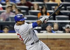 Chicago Cubs' Starlin Castro follows through on an hits an RBI single during the third inning of a baseball game against the New York Mets, Friday, Aug. 15, 2014, in New York. (AP Photo/Frank Franklin II)