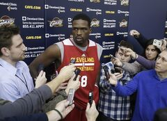 New Cleveland Cavaliers forward Luol Deng talks with reporters after his first practice with the NBA team at their practice facility in Independence, Ohio Wednesday, Jan. 8, 2014. The Cavaliers traded Andrew Bynum and future draft choices for the two-time All-Star Tuesday. (AP Photo/Mark Duncan)