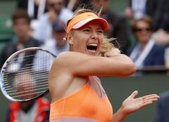 Russia's Maria Sharapova returns the ball to Spain's Garbine Muguruza during their quarterfinal match of the French Open tennis tournament at the Roland Garros stadium, in Paris, France, Tuesday, June 3, 2014. (AP Photo/Michel Euler)