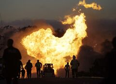 FILE - In this Sept. 9, 2010 file photo, a massive fire roars through a mostly residential neighborhood in San Bruno, Calif. A report released Friday by the Department of Transportation's inspector general says the federal agency responsible for making sure states effectively oversee the safety of natural gas and other pipelines is falling down on the job. (AP Photo/Paul Sakuma, File)