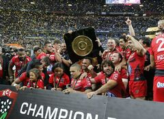 Toulon's rugby team holding the Bouclier de Brennus Trophy celebrate their victory over Castres during their Top 14 final rugby match at Stade de France stadium in Saint Denis, north of Paris, France, Saturday, May 31 2014. (AP Photo/Jacques Brinon)
