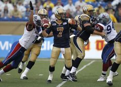 Winnipeg Blue Bombers' Alex Brink (7) is sacked by Montreal Alouettes' John Bowman (7) Friday at Canad Ins Stadium.
