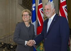 Ontario Premier Kathleen Wynne, left, shakes hands with Quebec Premier Philippe Couillard Thursday, August 21, 2014 at the premier's office in Quebec City. THE CANADIAN PRESS/Clement Allard