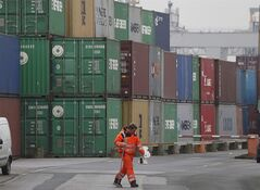 Containers are piled up at the Duisburg harbour, Germany, on, Feb. 14, 2013. THE CANADIAN PRESS/AP, Frank Augstein