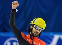 Charles Hamelin of Canada celebrates in Debrecen, Hungary, on Friday March 8, 2013. THE CANADIAN PRESS/AP, MTI, Tibor Illyes