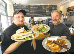 Jason Engelbretson, left, and Domenic Amatuzio with Cuban sandwich, salmon salad and breakfast plate.