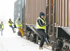 Tom Jarmoszko and fellow students practise mounting and dismounting at the RRC railway training facility.