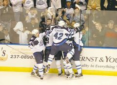 St. John's IceCaps players, including Mark Scheifele, celebrate a game-winning overtime goal against the Syracuse Crunch in Round 1 of the AHL playoffs.