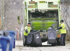An Emterra crew collects trash in the Wolseley neighbourhood in a November file photo.