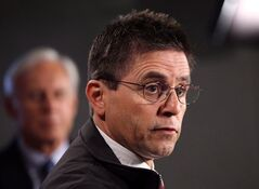Hassan Diab, the Ottawa professor who has been ordered extradited to France by the Canadian government, speaks at a press conference while his lawyer, Donald Bayne, listens on Parliament Hill in Ottawa on Friday, April 13, 2012. The Ontario Court of Appeal has upheld a decision that Diab should be extradited to France as a suspect in a decades-old terror bombing. THE CANADIAN PRESS/ Patrick Doyle