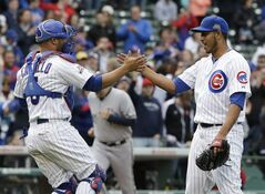 Chicago Cubs relief pitcher Hector Rondon, right, celebrates with catcher Welington Castillo after the Cubs defeated the Milwaukee Brewers 3-0 in a baseball game in Chicago, Saturday, May 17, 2014. (AP Photo/Nam Y. Huh)