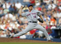 New York Mets pitcher Daisuke Matsuzaka (16) works in the first inning of a baseball game against the Atlanta Braves in Atlanta, Tuesday, July 1, 2014. (AP Photo/John Bazemore)