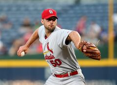 St. Louis Cardinals starting pitcher Adam Wainwright (50) delivers a pitch to an Atlanta Braves batter in the third inning of a baseball game, Wednesday May 7, 2014, in Atlanta. (AP Photo/Jason Getz)