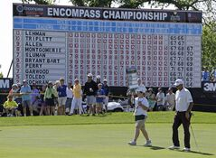 Tom Lehman, right, walks to the 18th green during the Encompass Championship golf tournament in Glenview, Ill., Sunday, June 22, 2014. (AP Photo/Nam Y. Huh)