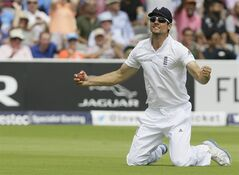 England's captain Alastair Cook celebrates as he catches out India's Stuart Binny for zero during the fourth day of the second test match between England and India at Lord's cricket ground in London, Sunday, July 20, 2014. (AP Photo/Kirsty Wigglesworth)