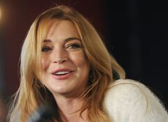 FILE - In this Jan. 20, 2014 file photo, actress Lindsay Lohan addresses reporters during a news conference at the 2014 Sundance Film Festival in Park City, Utah. Linsday Lohan is heading for the London stage _ in a play about the hysteria of Hollywood. Producers announced Thursday, June 26, 2014 that Lohan will make her professional stage debut in September in David Mamet's satirical drama