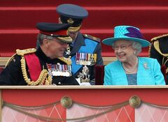 Queen Elizabeth II shares a joke with Chief of the Defense Staff General Sir David Richards, left, as they attend an Armed Forces Parade and Muster at Home Park Saturday May 19, 2012 in Windsor, England. Queen Elizabeth II is watching thousands of Royal Navy, Army and Royal Air Force troops parade outside her Windsor Castle home to mark her Diamond Jubilee. (AP Photo/Chris Jackson, Pool)