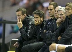 This is a Wednesday Aug. 6, 2014 file photo of Celtic manager Ronny Deila, left, and backroom team look dejected during the Champions League qualifying at Murrayfield, Edinburgh. UEFA said Friday Aug. 8, 2014, Scottish side Celtic has been reinstated to the Champions League playoffs after qualifying-round opponent Legia Warsaw was punished for fielding Bartosz Bereszynski an ineligible player. Legia won the third-round match 6-1 on aggregate after following up a 4-1 victory in the first leg with a 2-0 win at Murrayfield on Wednesday. (AP Photo/Jeff Holmes/PA, File) UNITED KINGDOM OUT NO SALES NO ARCHIVE
