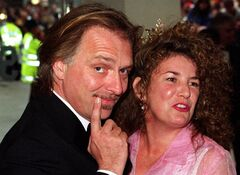 FiILE - This is a May 31 2000 file photo of British comedian and actor Rik Mayall with his wife Barbara. Mayall, one of a generation of performers that injected post-punk energy into British comedy, has died. He was 56. Mayall's management firm Brunskill Management said the comedian died early Monday June 9, 2014. (AP Photo/Peter Jordan/PA,File) UNITED KINGDOM OUT NO SALES NO ARCHIVE PHOTOGRAPH CAN NOT BE STORED OR USED FOR MORE THAN 14 DAYS AFTER THE DAY OF TRANSMISSION