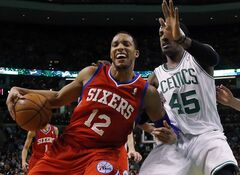 Philadelphia 76ers forward Evan Turner (12) makes a move against Boston Celtics forward Gerald Wallace (45) during the first half of an NBA basketball game in Boston, Wednesday, Jan. 29, 2014. (AP Photo/Elise Amendola)