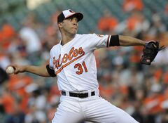Baltimore Orioles starting pitcher Ubaldo Jimenez delivers against the Detroit Tigers in the first inning of a baseball game Tuesday, May 13, 2014, in Baltimore. (AP Photo/Gail Burton)