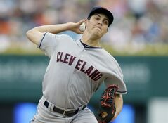 Cleveland Indians starting pitcher Trevor Bauer throws during the first inning of a baseball game against the Detroit Tigers in Detroit, Friday, July 18, 2014. (AP Photo/Carlos Osorio)