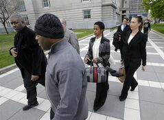 Singer Lauryn Hill, center, walks from federal court in Newark, N.J., Monday, April 22, 2013, after a judge postponed her tax evasion sentencing and scolded the eight-time Grammy winner for reneging on a promise to make restitution. Hill pleaded guilty last year to not paying federal taxes on $1.8 million earned from 2005 to 2007. At that time, her attorney said she would pay more than $500,000 by the time of her sentencing. It was revealed Monday in court that Hill has paid $50,000. The South Orange resident got her start with The Fugees and began her solo career in 1998 with the acclaimed album
