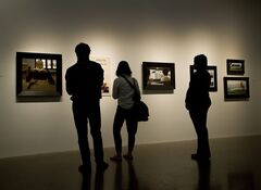People overlook the art of Alex Colville during a media preview of the largest exhibition of the late Canadian painter's work ever assembled, at The Art Gallery of Ontario in Toronto on Tuesday, August 19, 2014. THE CANADIAN PRESS/Nathan Denette