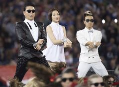Korean singer PSY, left, signs 'Gangnam Style' on stage at the half-time show as the Buffalo Bills play against the Seattle Seahawks during first half NFL football action in Toronto on Sunday, Dec. 16, 2012. It's getting harder and harder to find an Internet user who hasn't seen the veritably viral
