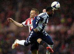 Sunderland's Seb Larsson, left, vies for the ball with West Bromwich Albion's Stephane Sessegnon, right, during their English Premier League soccer match at the Stadium of Light, Sunderland, England, Wednesday, May 7, 2014. (AP Photo/Scott Heppell)