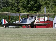 A World War I-era Curtiss Jenny original taxis after landing during an air show at the Old Rhinebeck Aerodrome on Sunday, July 6, 2014, in Rhinebeck, N.Y. (AP Photo/Mike Groll)
