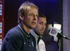 United States World Cup soccer team coach Jurgen Klinsmann, left, and team captain Clint Dempsey answer questions during a news conference, in New York, Friday, May 30, 2014.(AP Photo/Richard Drew)