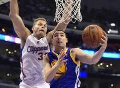FILE - In this Tuesday, April 29, 2014, file photo, Golden State Warriors guard Klay Thompson, right, puts up a shot as Los Angeles Clippers forward Blake Griffin defends during the second half in Game 5 of an opening-round NBA basketball playoff series, in Los Angeles. The Minnesota Timberwolves' Kevin Love headlines a list of veteran NBA players who could have a major influence on how the draft unfolds, Thursday, June 26, 2014. Love's contract situation has the Timberwolves contemplating trading him, and several teams could use first-round picks as part of a package to acquire him. Orlando's Arron Afflalo and Golden State's Thompson could be on the move as well, while soon-to-be free agents like Toronto's Kyle Lowry and Phoenix's Eric Bledsoe could have a say in which direction their current teams go with draft picks. (AP Photo/File)