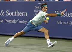 Roger Federer, of Switzerland, returns to Milos Raonic, from Canada, during a semifinal at the Western & Southern Open tennis tournament, Saturday, Aug. 16, 2014, in Mason, Ohio. Federer won 6-2, 6-3. (AP Photo/David Kohl)