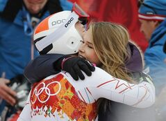 United States' Bode Miller embraces his wife Morgan near the finish area after completing Men's super combined downhill training at the Sochi 2014 Winter Olympics, Tuesday, Feb. 11, 2014, in Krasnaya Polyana, Russia. (AP Photo/Christophe Ena)