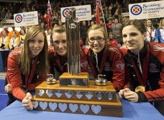 Ontario's skip Rachel Homan, left. third Emma Miskew, second Alison Kreviazuk and lead Lisa Weagle pose with the trophy afterr winning the Scotties Tournament of Hearts Sunday, February 24, 2013 in Kingston, Ont. THE CANADIAN PRESS/Ryan Remiorz