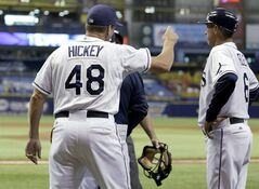 Tampa Bay Rays pitching coach Jim Hickey (48) argues with home plate umpire Marty Foster after he was ejected by Foster during the first inning of a baseball game Thursday, May 8, 2014, in St. Petersburg, Fla. Looking on is Rays' third base coach Tom Foley. (AP Photo/Chris O'Meara)