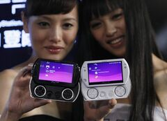 FILE - In this Sept. 16, 2009 file photo, models hold Sony PlayStation Portable video game machines during a promotional event in Hong Kong. Sony Corp. is pulling the plug on its hand-held PlayStation Portable video game machine after 10 years. The Japanese electronics and entertainment company has been pushing the successor machine, PlayStation Vita. (AP Photo/Kin Cheung, File)