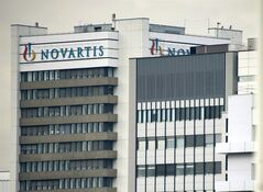 FILE - This Oct. 25, 2011 file photo shows the logo of Swiss pharmaceutical company Novartis AG on one of their buildings in Basel, Switzerland. Swiss pharmaceutical company Novartis AG posted a 3 percent rise in second-quarter profits Thursday, July 17, 2014, reflecting what it described as solid growth and an increased focus on core products. Profits during the April-June quarter rose to $3.28 billion, up from $3.18 billion in the same quarter of 2013, helped by