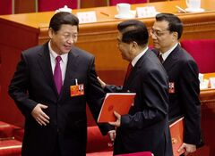 China's newly-installed President Xi Jinping, left, chats with former chairman of the Chinese People's Political Consultative Conference Jia Qinglin, center, and newly-appointed Premier Li Kiqiang, right, after the closing ceremony of the National People's Congress at the Great Hall of the People in Beijing Sunday, March 17, 2013. China's new leaders pledged to run a cleaner, more efficient government and slash spending on official perks Sunday as the ceremonial legislature wrapped up a pivotal session to install a new leadership in a once-a-decade transfer of power. (AP Photo/Andy Wong)
