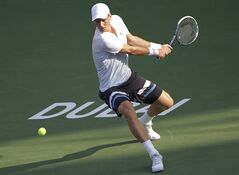 Tomas Berdych of Czech returns the ball to Sergiy Stakhovsky of Ukraine during the third day of the Dubai Duty Free Tennis Championships in Dubai, United Arab Emirates, Wednesday, Feb. 26, 2014. (AP Photo/Kamran Jebreili)