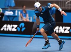 Andy Murray of BritaiN rushes for a return shot to Feliciano Lopez of Spain during their third round match at the Australian Open tennis championship in Melbourne, Australia, Saturday, Jan. 18, 2014.(AP Photo/Rick Rycroft)