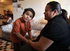 St. Theresa Point First Nation's Rachel Mason and her son Kieren were stuck in Winnipeg for treatment after her son suffered a head injury. They were going back to a home without running water.