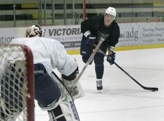 Alexander Burmistrov (right) has been invited to the St. John's IceCaps training camp.